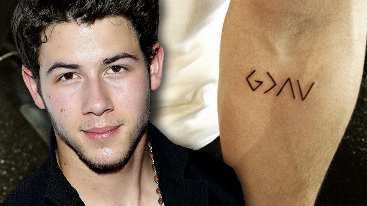 Nick jonas gets new meaningful tattoo youtube for Nick jonas tattoo