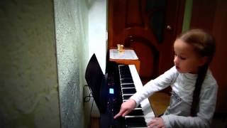 Girl. Piano playing. Девочка играет на пианино.