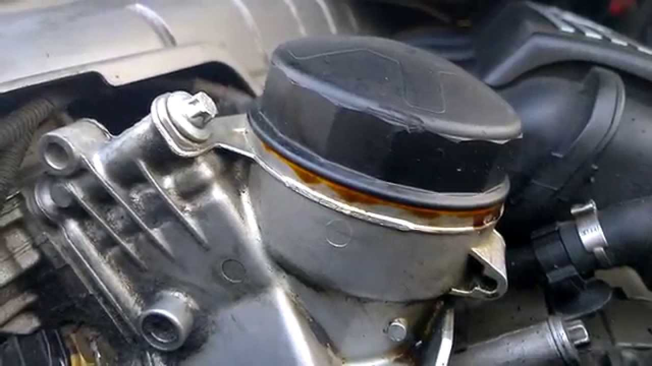 oil ing out of oil filter housing 2006 e90  YouTube