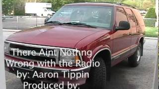 there aint nothing wrong with the radio music video by aaron tippin