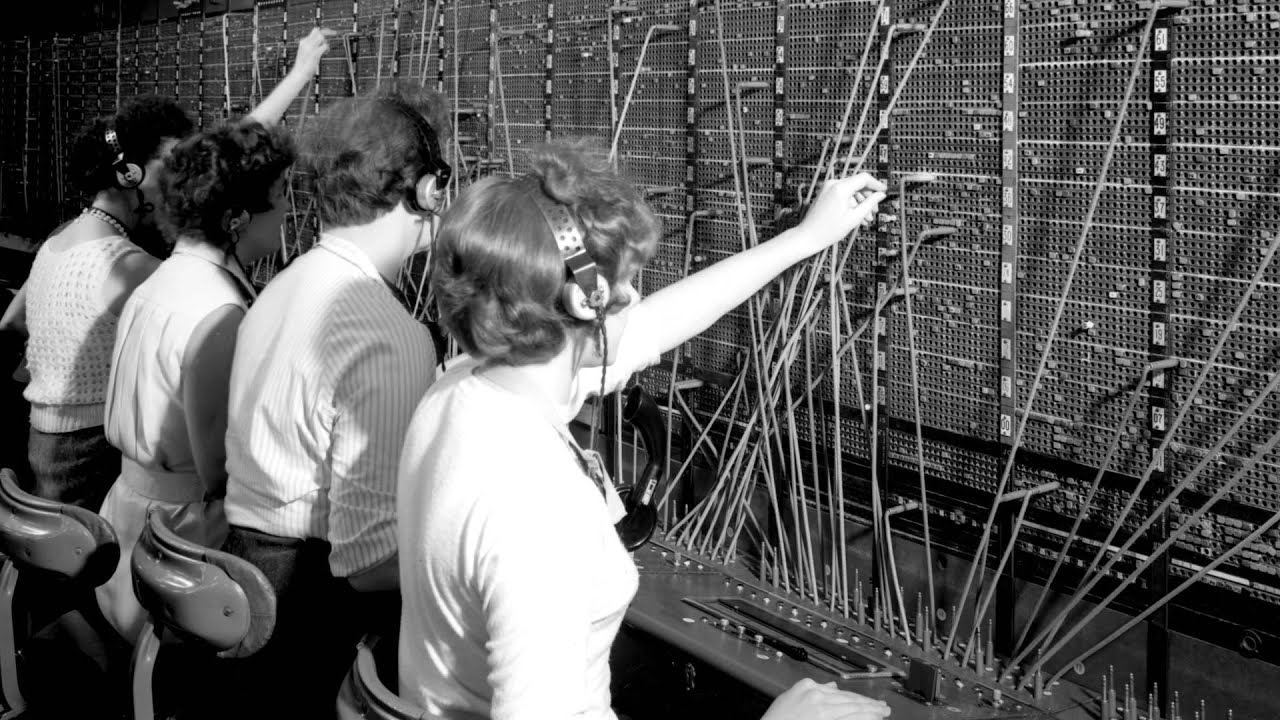Old fashioned telephone exchange worker 76