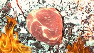What happens if you cook a raw steak directly in hot coals?