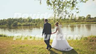 The bride and groom walk to the river bank
