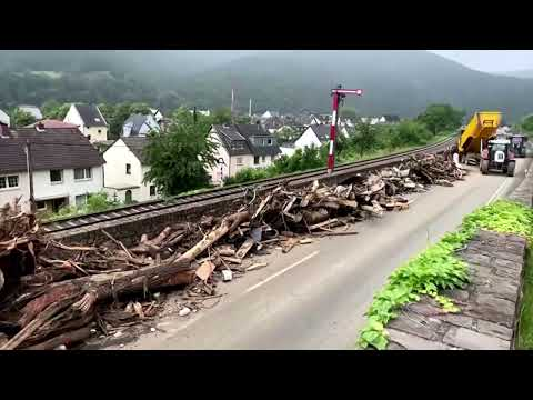 German flood deaths rise as search continues