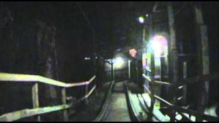 The Underground Wooden Roller Coaster Dark Ride Lights On Front Seat POV Adventureland