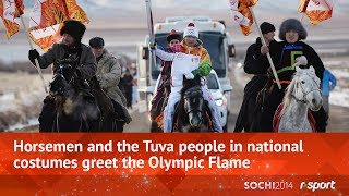 Horsemen and the Tuva people in national costumes greet the Olympic Flame