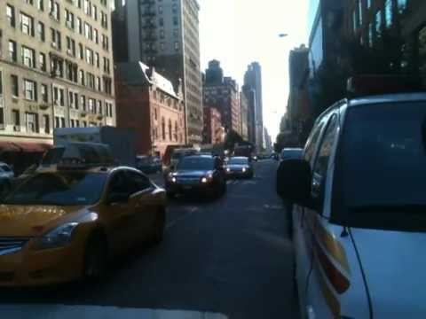 AMBULANCE FROM MOUNT SINAI HOSPITAL WITH LIGHTS & SIRENS ON WEST SIDE OF NEW YORK CITY.