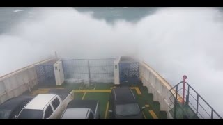 Ferry Boat enters storm and get hit by tidal waves! Watch til end!