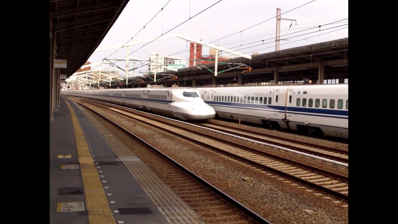 Limited Stop Shinkansen Japanese Bullet Train Fly By While The Local Shinkansen Waits