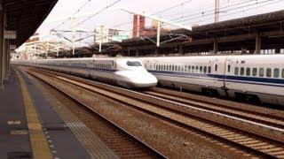 Limited Stop Shinkansen (Japanese Bullet Train) fly by, while the Local Shinkansen waits!