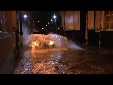 LOWER FERRY HIGH TIDE CARS IN WATER DARTMOUTH UK OCT 17th 2012