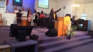 singing at world harvest church of God- Ishika Charles