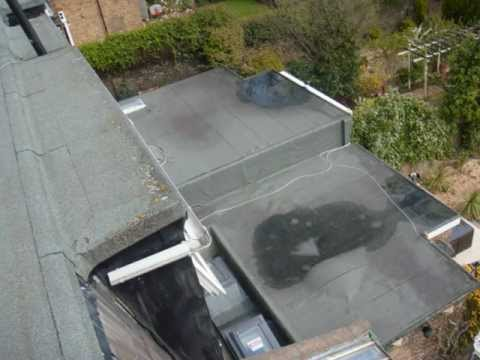 Flat roof with a puddle in the middle