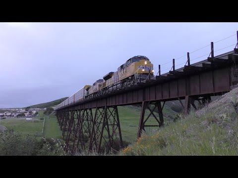 UP 8801 Leads Autoracks Across Stenner Creek Trestle - 4K