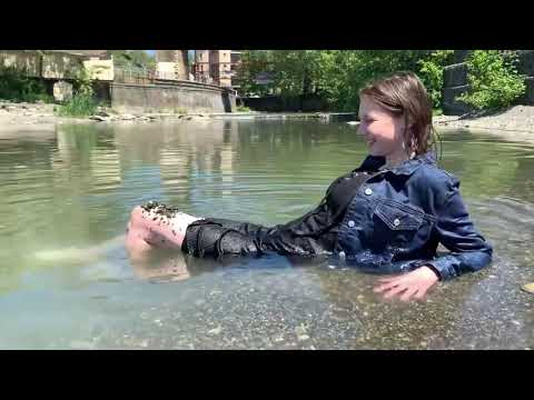 Wetlook Elena Vika in a black dress and a denim jacket in a small river