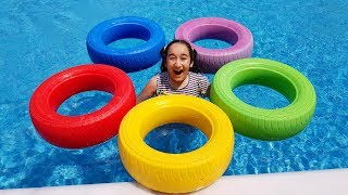 Kids playing with colored wheels in the pool, Fun kid video
