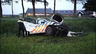 Politiewagen over de kop na ongeval in Oosterhesselen
