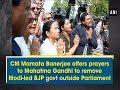 CM Mamata Banerjee offers prayers to Mahatma Gandhi to remove Modi-led BJP govt outside Parliament