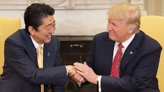Trump shakes Japanese PM