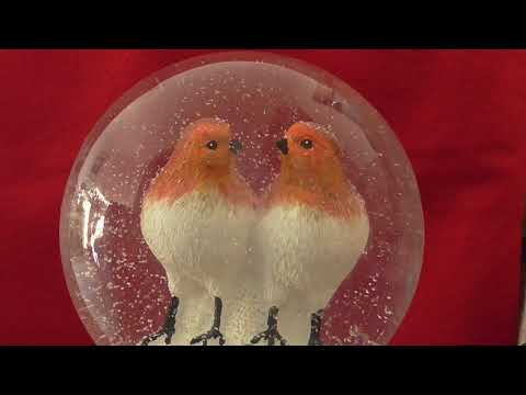Two snowglobe  robins in slanging match, Man United Liverpool supporters .Subtitles.