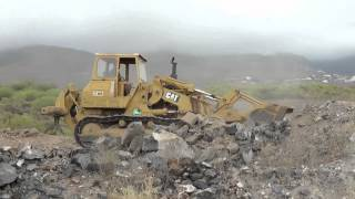 Caterpillar 977L Traxcavator moving volcanic rock near Adeje, Tenerife