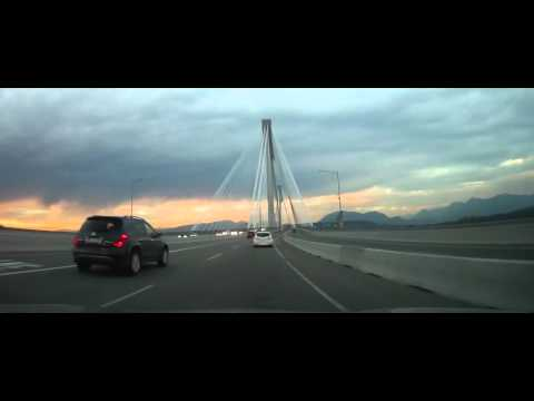 Driving Across The Port Mann Bridge in Vancouver, BC - During Sunset