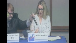 Rep. Duane Quam Grabs Microphone from Opponent at Debate
