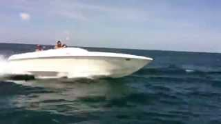 Ripping across the ocean in 454 JAWS Speed Boat jumping waves