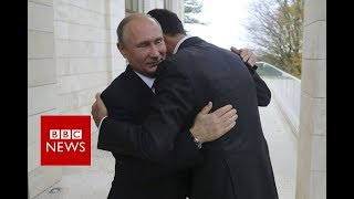 Russia's Putin visits Syria airbase and orders start of pullout - BBC News