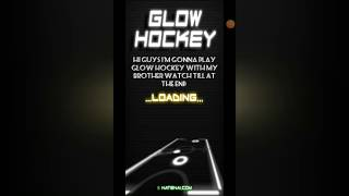 Playing glow hockey with my brother