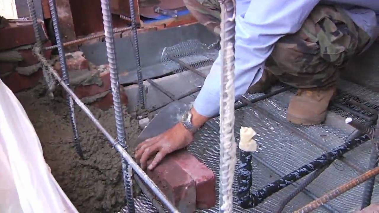 Demolishing an earthquake damaged brick chimney. Installing rebar for an engineered brick chimney. Laying brick on a reinforced brick chimney. Time Lapse vid...