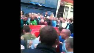 Liverpool fan get's his car kicked in on gwladys Street