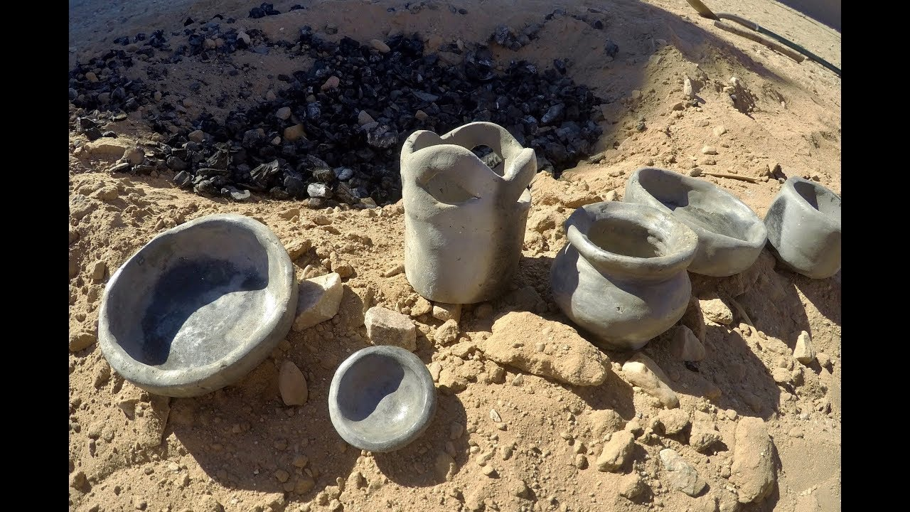 Primitive Pottery: Firing Wild Clay with a Pit Fire - YouTube