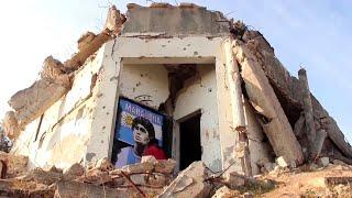 Siria, tra le macerie delle case bombardate spunta un murale dedicato a Maradona