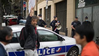 France: Demonstrators form human chain to protest police violence during lockdown