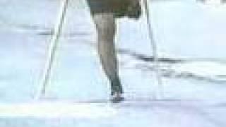One-legged female street crutching