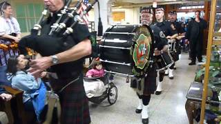 Seattle Firefighters Pipes and Drums march on Alaska Day. in Sitka