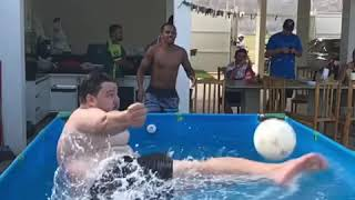 Guy in Pool Kicks Ball into Friend's Face - 1020510