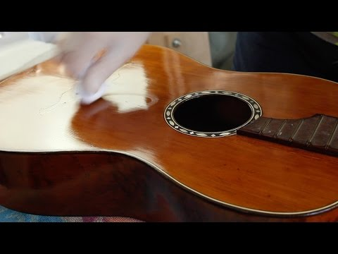 Restoring an antique parlour guitar part 32: French polishing with olive oil