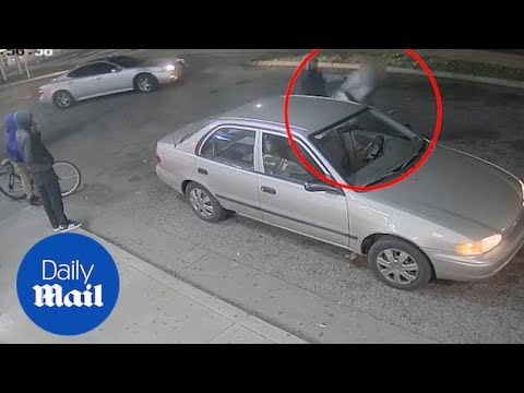 Philadelphia suspects pistol-whip a man during a carjacking - Daily Mail