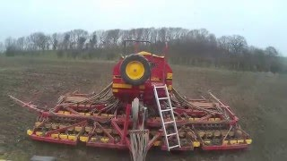 spring drilling naked-oats- vaderstad 6m, claas challenger 55