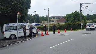 Police cordon off entrance to Najib's private residence in Taman Duta