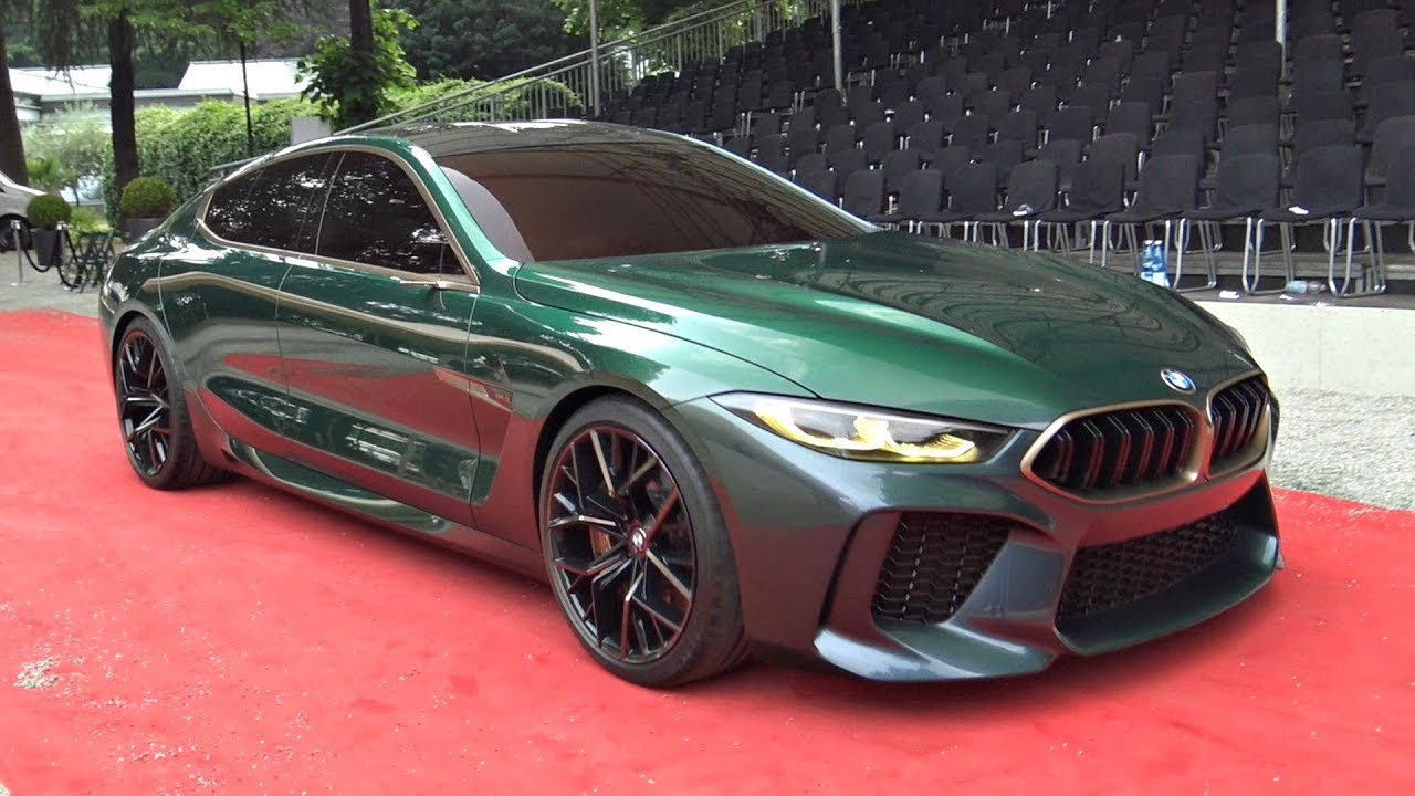hight resolution of bmw m8 gran coupe concept driving on the road for the first time overview more