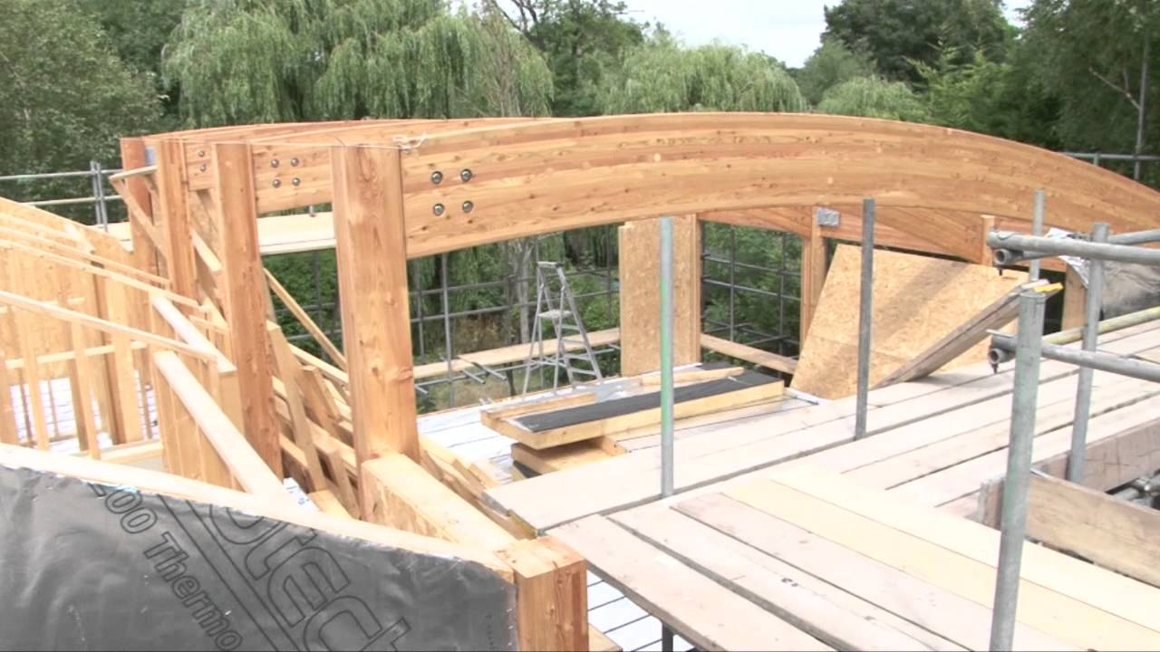 Custom timber frame house build youtube for How to build an a frame home