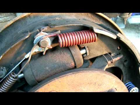 How to arrange the springs, levers, and cables in a Ford truck drum