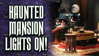 lights on walkthrough of the haunted mansion at walt disney world