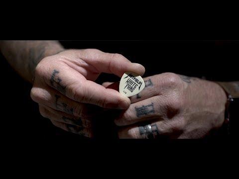 Sherri Marengo - James Hetfield shows off a new White Fang guitar pick
