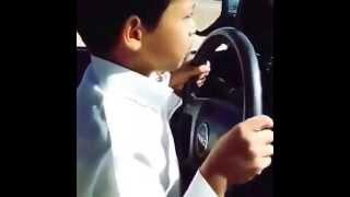 A Saudi Kid driving a car on 200 kmh