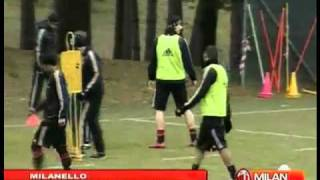 Zlatan Ibrahimovic jokes with teammates during a training session