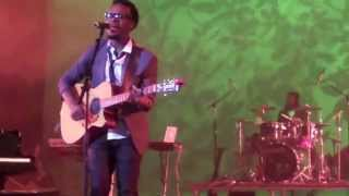 Travis Greene singing How He Loves